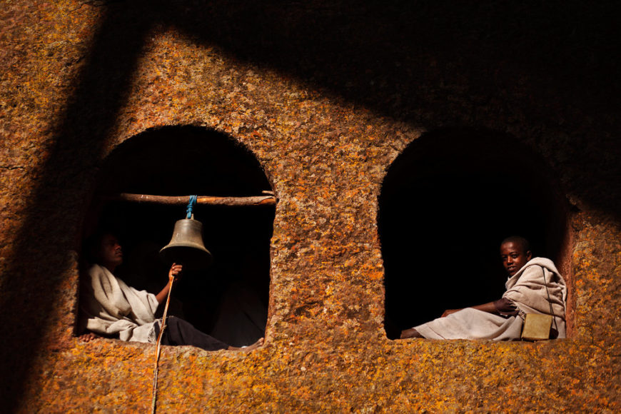 Pilgrim-boys-sitting-in-windows-of-a-church,-Lalibela,-Ethiopia